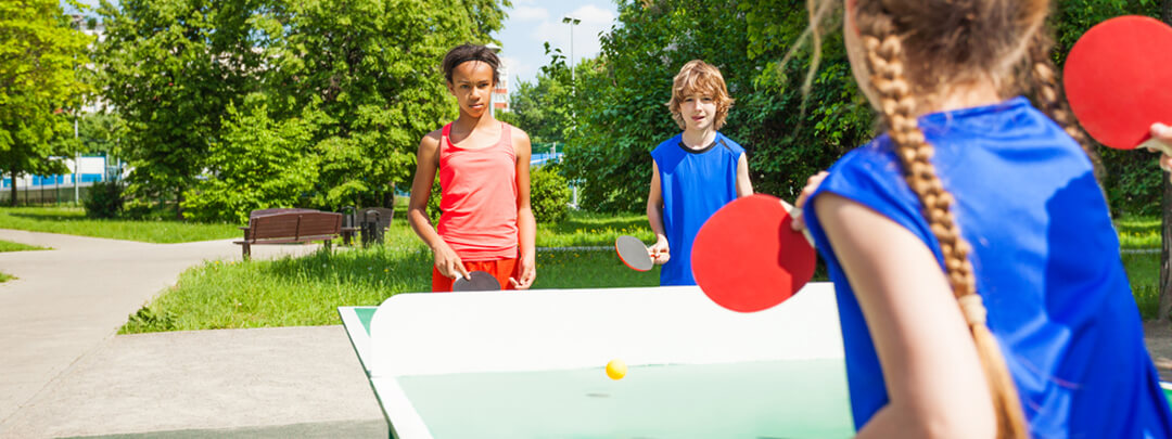 Kids Playing Ping Pong in their Backyard