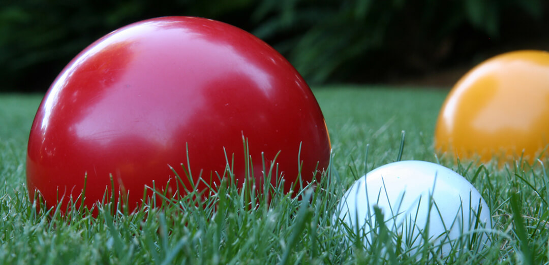 Bocce Balls in Backyard Grass